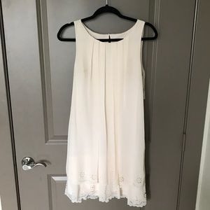 Sundress with ruffles on bottom trim and back!